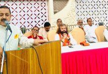 Union Minister Dr Jitendra Singh addressing a BJP public meeting, at New Delhi.Also seen are Member of Parliament Hans Raj Hans and Leader of Opposition in Delhi Legislative Assembly Vijender Gupta.