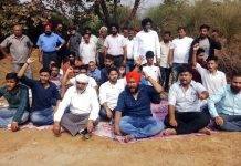 Transporters and activists of other organisations protesting at Sarore on Tuesday.