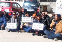 Agriculture Department employees staging protest outside their office at Leh on Monday. -Excelsior/ Morup Stanzin