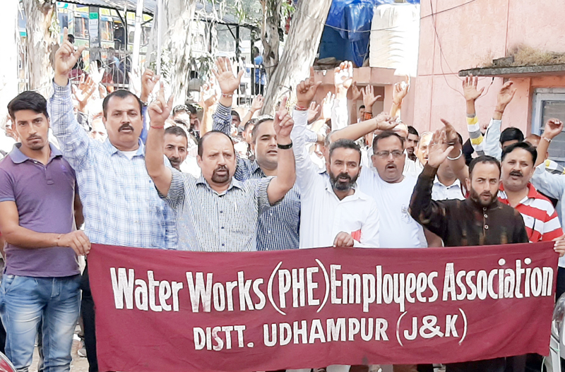 PHE workers staging protest at PHE complex, Udhampur.