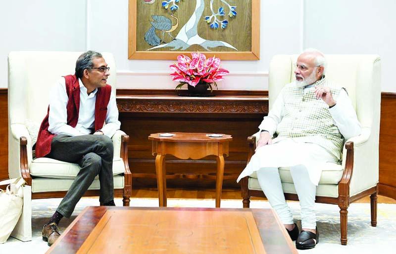 Economics Nobel Prize winner Abhijit Banerjee meeting Prime Minister Narendra Modi, in New Delhi on Tuesday. (UNI )