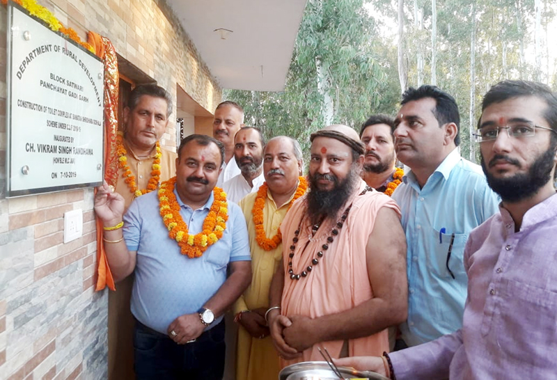Ch. Vikram Randhawa, ex MLC and senior BJP leader inaugurating a toilet complex at Gadigarh on Wednesday.