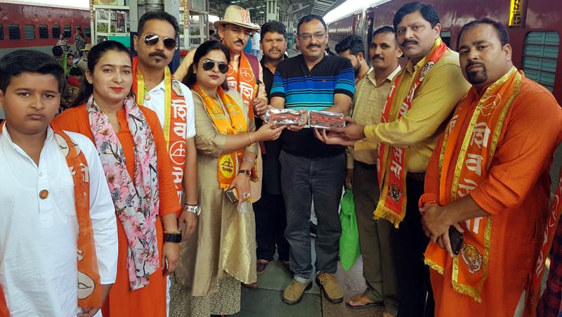 Shiv Sainiks distributing Saheb Khana at Railway Station on Wednesday.