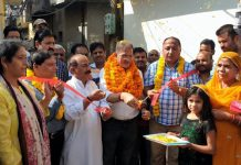 Former Deputy CM, Kavinder Gupta kick starting black topping of road at Satwari on Sunday.