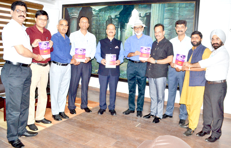 JU VC releasing a book authored by Prof Shubhnandan Jamwal.