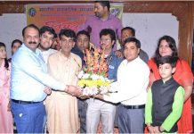 Chief guest Raman Suri and artists from Vomedh receiving a bouquet from Regional Director, ICCR, NK Shil during a function in Jammu.