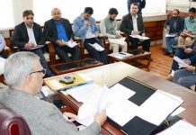 Advisor Farooq Khan charing a meeting on Friday.
