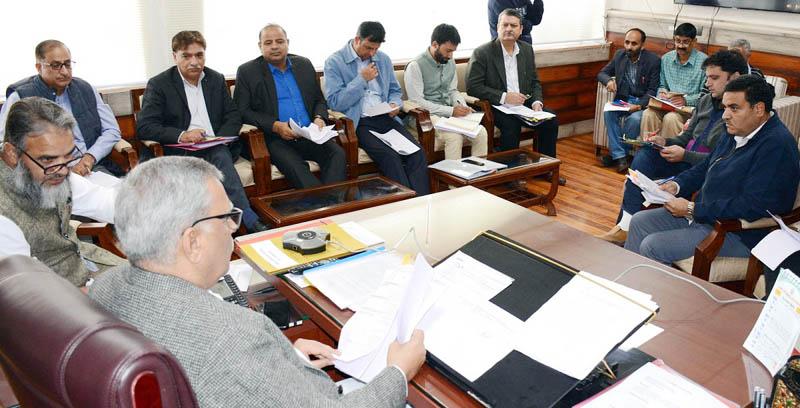 Advisor Farooq Khan charing a meeting on Friday.