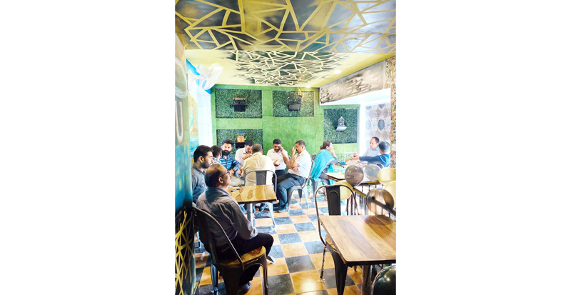 Customers enjoying tea at newly opened outlet of 'The Tea Factory' at Greater Kailash, Jammu.