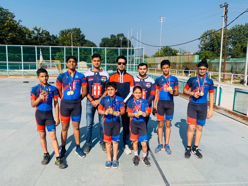 Skaters posing for group photograph after winning medals in CBSE North Zone Skating Championship.