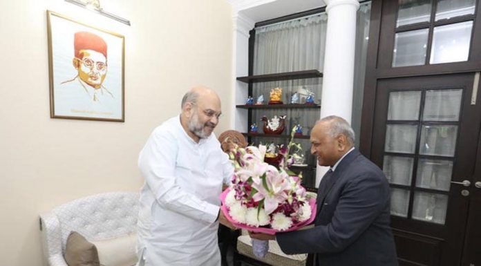 Lieutenant Governor of Ladakh, R K Mathur meeting Union Home Minister Amit Shah in New Delhi on Saturday.