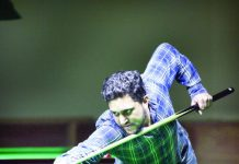 Cueist Shubam Dubey aiming at target during a match in Senior Snooker at Billiards Hall, MA Stadium, Jammu on Thursday. —Excelsior/Rakesh