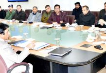 Lieutenant Governor chairing meeting of officers in Srinagar on Monday.
