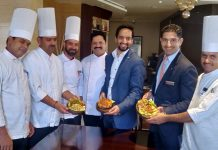 MD Ramada Jammu Siddhant Chowdhary and chefs of the hotel displaying aromatic smoke infused delicacies.