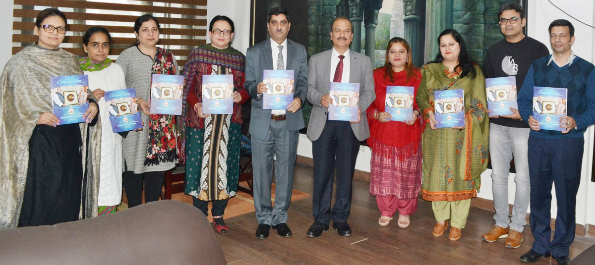 JU VC alongwith Registrar and others releasing campus newsletter on Monday.