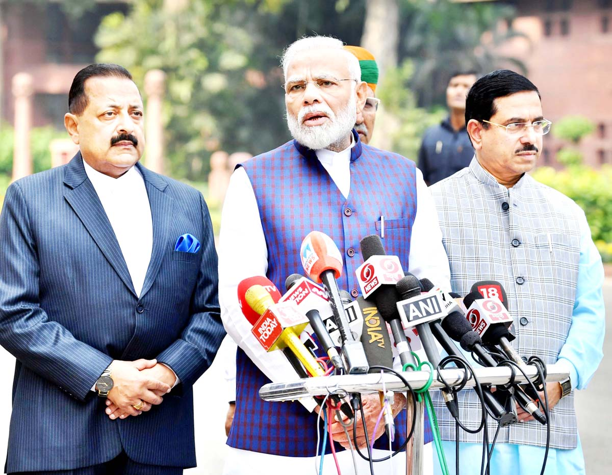 Prime Minister Narendra Modi addressing the media on his arrival at Parliament House, on the first day of the winter session, at New Delhi on Monday.