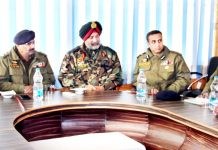 DGP Dilbag Singh and GOC 15 Corps Lt General KJS Dhillon chairing a meeting of officers at DPL Bandipora.