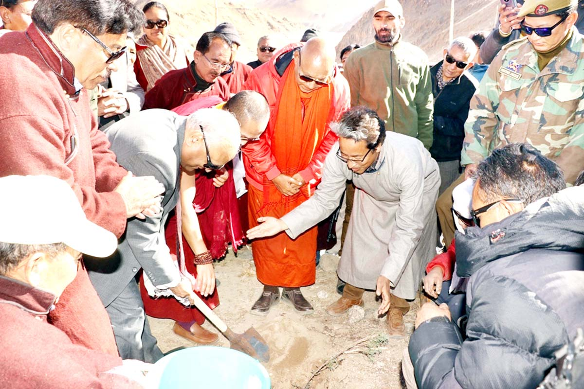 Lieutenant Governor of Ladakh R K Mathur digging the land for planting a sapling in Leh on Monday.