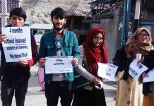 Students carrying placards during protest at Kargil. —Excelsior/Basharat Ladakhi
