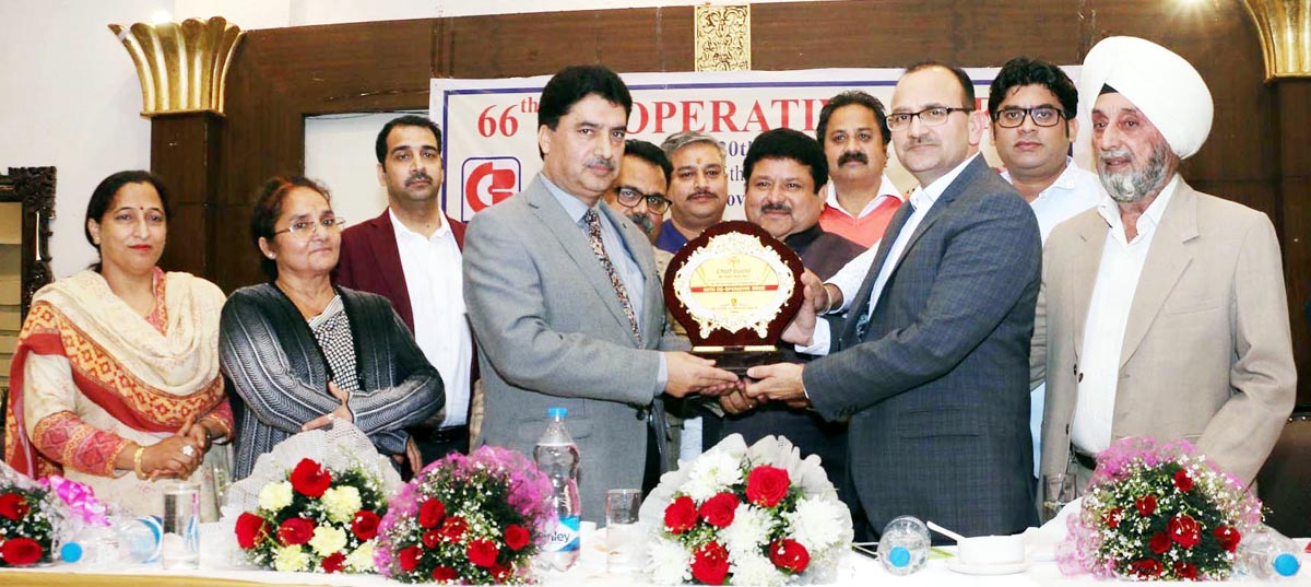 Registrar Cooperative societies, Asif Hamid Khan being honoured by CCB Director, Parveen Sharma and others at Jammu on Monday.