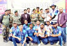 Winners of Dhanidar Premier League posing along with chief guest and other dignitaries in Rajouri.