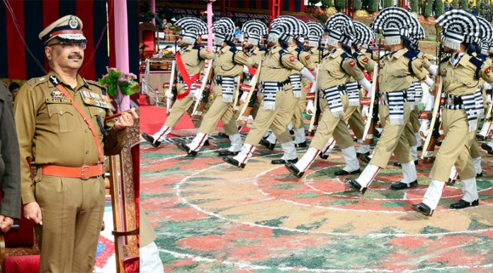 Lt Governor G C Murmu taking salute during passing out parade by new recruits of J&K Police at Manigam in Ganderbal on Monday. —Excelsior/Shakeel