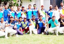 Players of JU and Media-XI Cricket Club Jammu posing for group photograph after friendly match at Jammu University ground on Sunday.