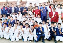 Medal winners posing for photograph with SSP Kathua Sridhar Patil and others. -Excelsior/Pardeep
