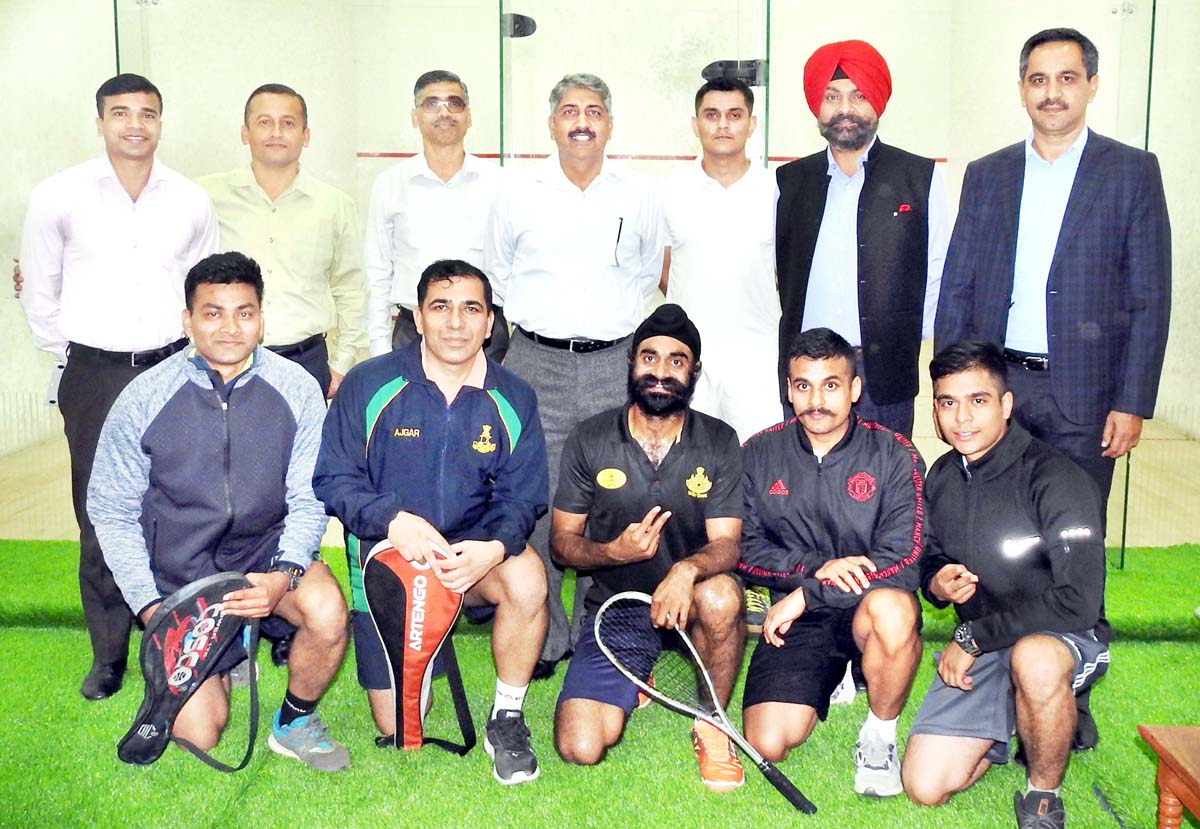 Winners of Squash Championship posing for a group photograph at KCSC in Jammu.