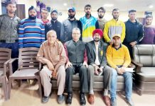Selected cyclists posing for photograph with Ravi Singh, Divisional Sports Officer, J&K Sports Council and others at Jammu on Sunday.