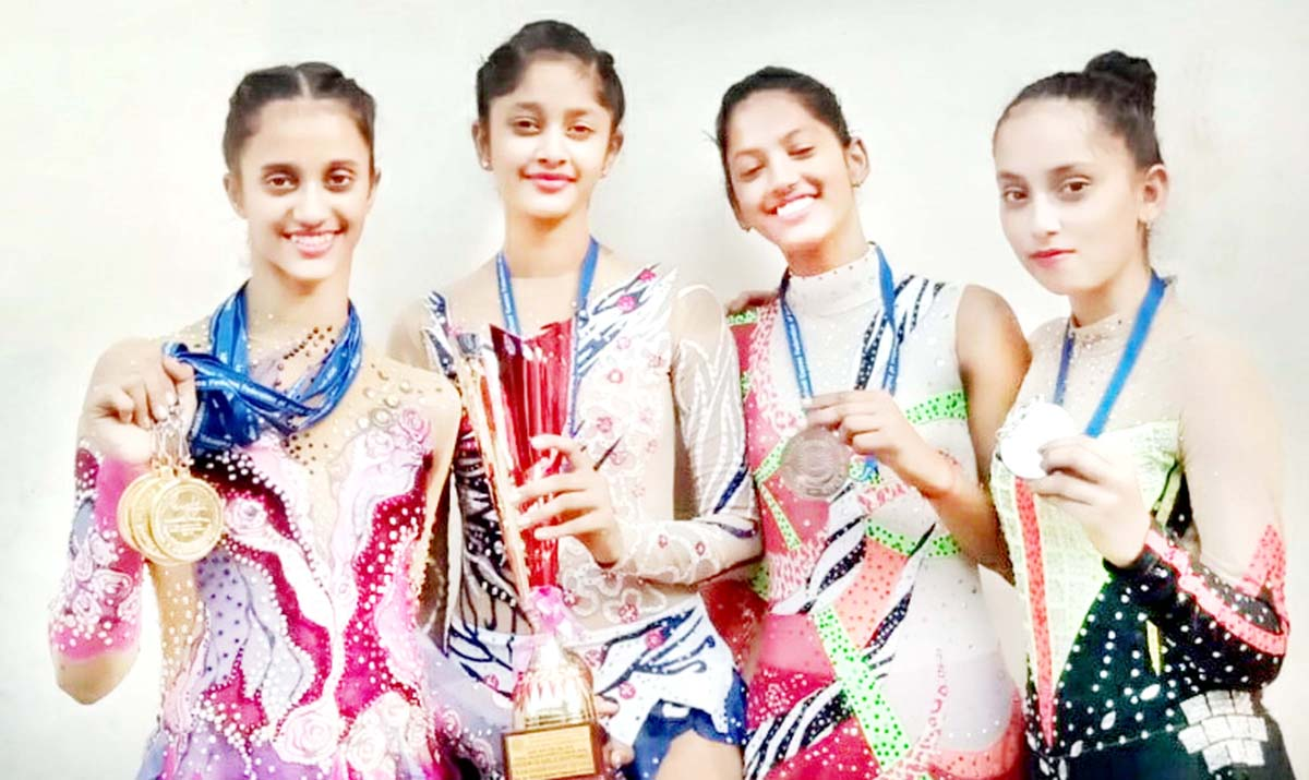 Bavleen Kour and other J&K Gymnast posing for a photograph after excelling in 65th National School Games at Agra.