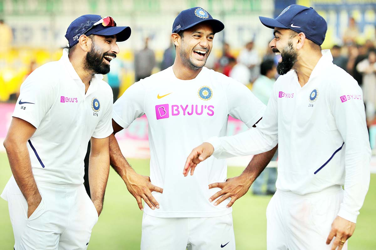 Mohammed Shami, Mayank Agarwal and Virat Kohli share a moment during India vs Bangladesh, 1st Test at Indore.