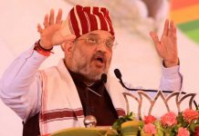 Union Minister for Home Amit Shah addressing an election rally in Lohardaga, Jharkhand on Thursday. (UNI)