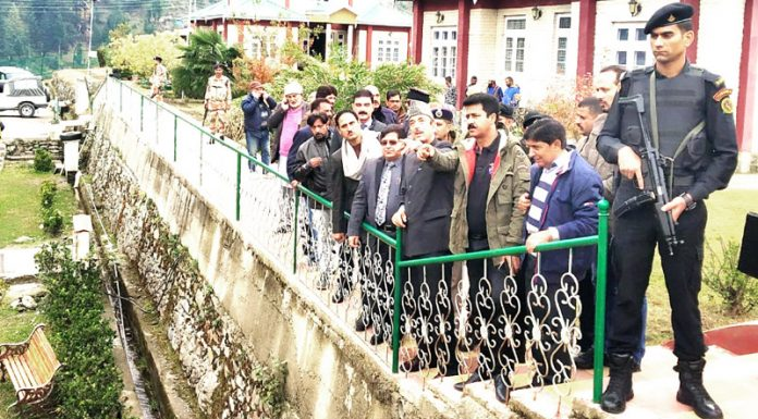 Senior AICC leader Ghulam Nabi Azad alongwith party activists inspecting development work at Bhaderwah on Thursday. -Excelsior/Tilak Raj