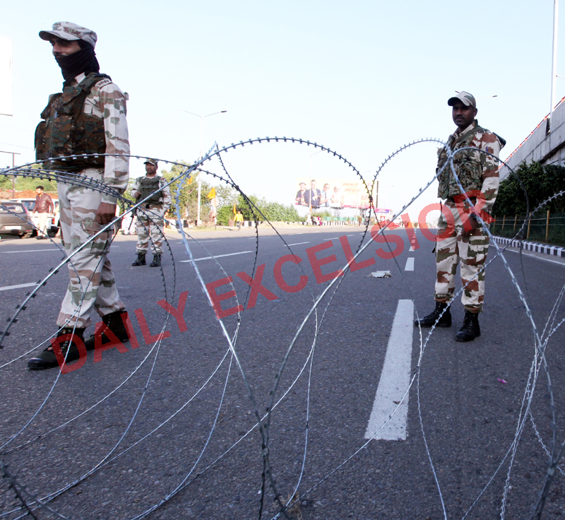 Para-military personnel guard a Jammu City road on Saturday.  -Excelsior/Rakesh
