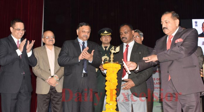 Union Minister Dr Jitendra Singh, LG, GC Murmu and other dignitaries lighting a lamp at inaugural occasion of two-day conference on good governance at Jammu on Friday. -Excelsior/Rakesh