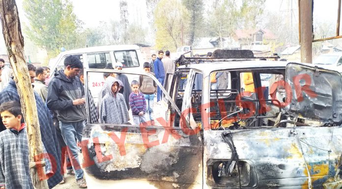 Two cars set ablaze in Kulgam. -Excelsior/ Sajad Dar