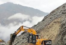 A JCB clearing highway at Digdol near Ramban on Friday. -Excelsior/Parvaiz Mir