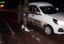 Army jawans pushing the car trapped in snow at Zojila in Kargil area.