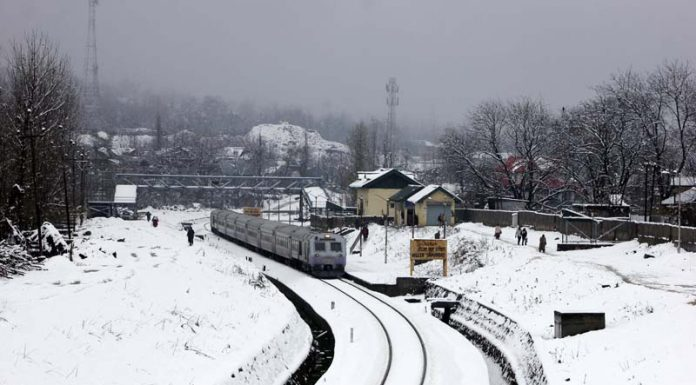 Train chuggs on track filled with snow from Baramulla to Banihal. -Excelsior/Sajad Dar