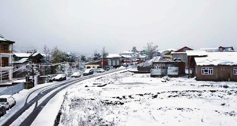 A view of snowfall in Bhaderwah town. -Excelsior/Tilak Raj