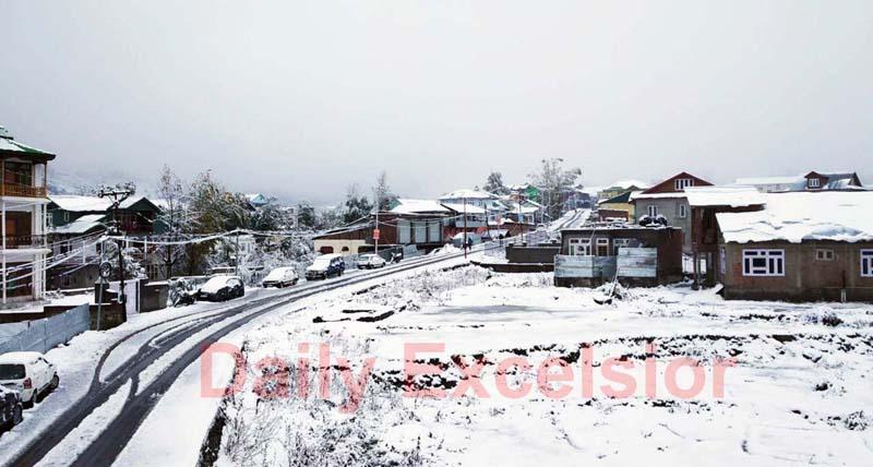 A view of snowfall in Bhaderwah town. -Excelsior/Tilak Raj
