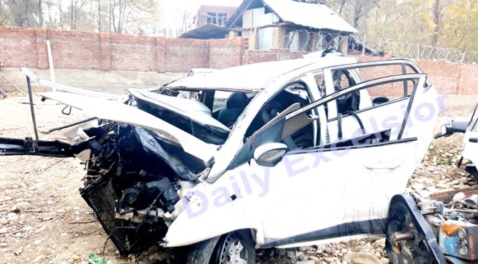 A car badly damaged in accident at Wanpoo, Kulgam on Wednesday. -Excelsior/Sajad Dar