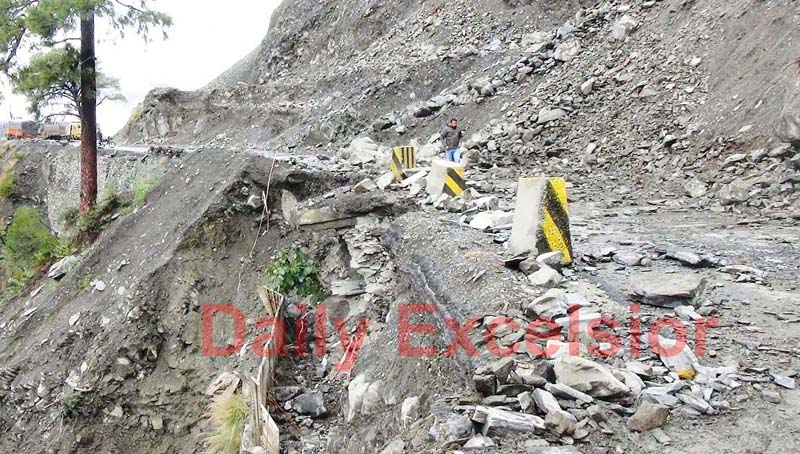 Machines pressed into service for clearing landslides and shooting stones on Jammu-Srinagar Highway. -Excelsior/ Parvaiz Mir