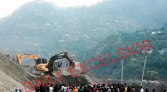 Machines at work to clear debris following fresh landslide at Mehar in Ramban on Saturday. -Excelsior/Parvaiz Mir