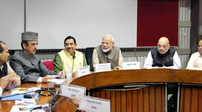 Prime Minister Narendra Modi, Home Minister Amit Shah, Congerss leader Ghulam Nabi Azad and other leaders during the All Party Meeting on the eve of the Winter Session of Parliament in New Delhi on Sunday. (UNI)