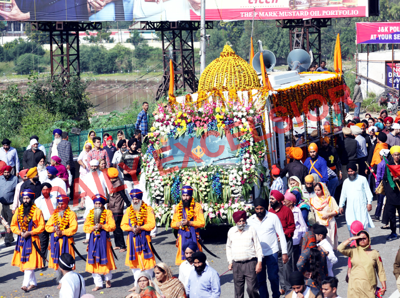 'Nagar Kirtan' being taken out in Jammu on the eve of 550th Prakash Parv of Guru Nanak Dev Ji on Saturday. -Excelsior/Rakesh