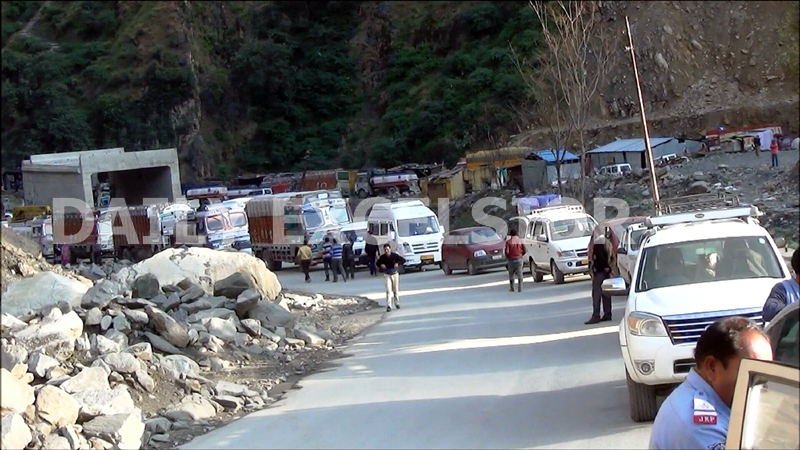 Passenger vehicles and trucks stranded near Ramban following fresh landslide at Digdol on Sunday. -Excelsior/Parvaiz Mir