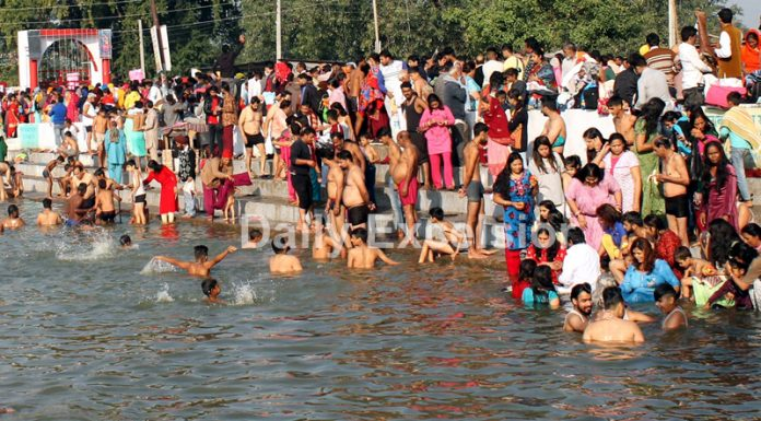 Devotees taking a dip in holy pond as nine-day long Jhiri mela begins on Tuesday. —Excelsior/Rakesh