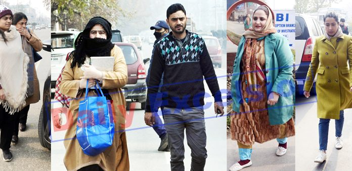People on way to meet their relatives and family members at MLAs' Hostel in Srinagar on Wednesday. -Excelsior/Shakeel